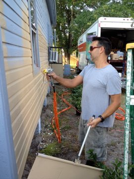 Jack painting community house in Ybor
